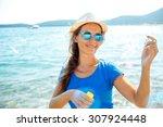 happy young brunette girl... | Shutterstock . vector #307924448