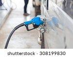 fuel nozzle at a car service. | Shutterstock . vector #308199830