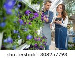 male florist looking at female... | Shutterstock . vector #308257793