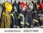 firefighter suits and helmets... | Shutterstock . vector #308257880