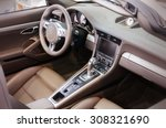 Dark luxury car Interior - steering wheel, shift lever and dashboard - stock photo