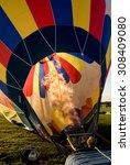 hot air balloon being inflated... | Shutterstock . vector #308409080