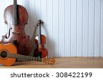 Musical Instruments On Wooden...