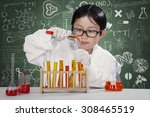 little schoolboy wearing coat... | Shutterstock . vector #308465519