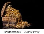 old wooden chest with pile of... | Shutterstock . vector #308491949