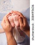 baby feet on parents hands at... | Shutterstock . vector #308495636