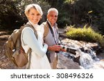 cheerful middle aged hikers... | Shutterstock . vector #308496326