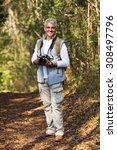 cheerful mid age man with dslr... | Shutterstock . vector #308497796