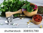 Small photo of Alternative medicine herbs and stethoscope on wooden table background