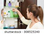 beautiful girl choosing beauty... | Shutterstock . vector #308525240