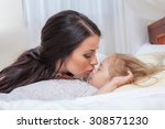 happy mother and daughter in bed | Shutterstock . vector #308571230