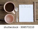 to do list word on wooden table ... | Shutterstock . vector #308573210