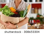 young woman holding grocery... | Shutterstock . vector #308653304