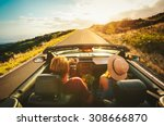 happy young couple driving... | Shutterstock . vector #308666870