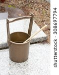 Small photo of Japanese ablutionary bucket and ladle in grave yard