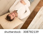 a young man meditating on the... | Shutterstock . vector #308782139