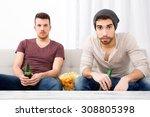 two guys watching tv  drinking... | Shutterstock . vector #308805398