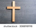 wooden cross on rusty black... | Shutterstock . vector #308898998
