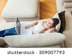 woman using a laptop in her home | Shutterstock . vector #309007793