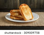 dish with toasts on wooden... | Shutterstock . vector #309009758