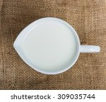 cow milk and ceramic jug on... | Shutterstock . vector #309035744