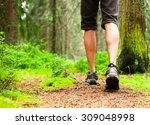 male hiking in the woods.  | Shutterstock . vector #309048998