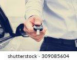 a man giving car key  vintage... | Shutterstock . vector #309085604