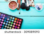 colorful cosmetics on blue... | Shutterstock . vector #309089093