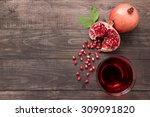 ripe pomegranates with juice on ... | Shutterstock . vector #309091820