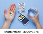 taking pill with hand holding... | Shutterstock . vector #309098678
