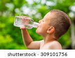 closeup of young boy drinking... | Shutterstock . vector #309101756