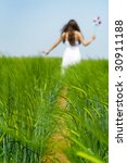 Girl Walking In A Green Field ...