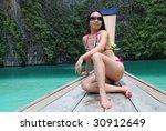 asian beauty in bikini seated... | Shutterstock . vector #30912649