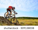 cyclist riding the bike down... | Shutterstock . vector #309138038