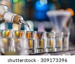 barman pouring hard spirit into ... | Shutterstock . vector #309173396