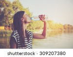 woman drinking water | Shutterstock . vector #309207380