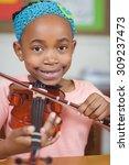 portrait of smiling pupil... | Shutterstock . vector #309237473