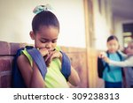 sad pupil being bullied by... | Shutterstock . vector #309238313