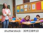 teacher standing by her... | Shutterstock . vector #309238910