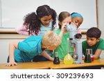 students using science beakers... | Shutterstock . vector #309239693