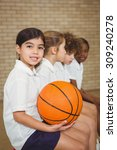 student holding basketball with ... | Shutterstock . vector #309240278