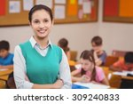 teacher smiling at camera in... | Shutterstock . vector #309240833