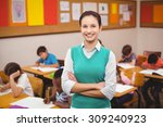 teacher smiling at camera in... | Shutterstock . vector #309240923