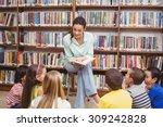 Teacher Reading Her Pupils A...