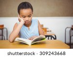 concentrated student reading a... | Shutterstock . vector #309243668