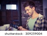 smiling hipster sitting and... | Shutterstock . vector #309259004
