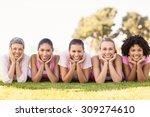Portrait Of Smiling Women Lyin...