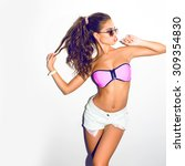 Small photo of Stylish fashionable girl hipster with lolly pop in casual teen clothes.White background.Summer vibes,sunglasses fashion,girl in pink clothes,fashion swagger outfit,play with ponytail.joy having fun