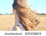 Wind Flutters Young Girls Hair