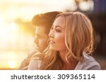 romantic couple cuddling on... | Shutterstock . vector #309365114